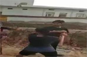 girl beats a boy with a stick