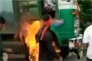 workers set ablaze a truck in maharashtra