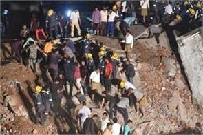 four storey building collapsed in ahmedabad ten drowned
