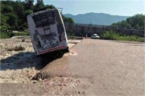 bus filled with passengers flattened in river