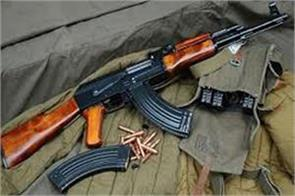 militants snatched rifle from bank guard