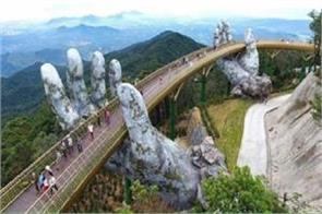 new footbridge held up b two giant hands da nang vietnam