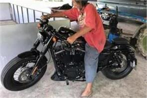 a old man weaing ugly clothes bought harley davidson