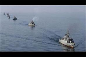 us officials says iran readying military exercise in persian gulf