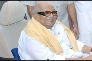 karunanidhi gave a school and library in mumbai for financial help