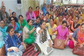 female health workers goes on strike
