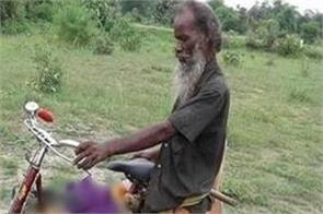 man carries sister in law body on bicycle