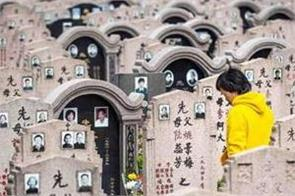 outcry as coffins crushed in chinese  zero burial  campaign