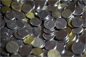 rupee ends positive at 69 90 against usd