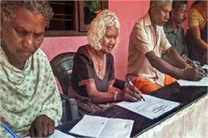 96 year old woman sitting in literacy examination in kerala