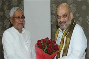 nitish meets amit shah on  dignified  split of seats
