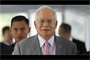 najib razak blamed 21 cases of money laundering