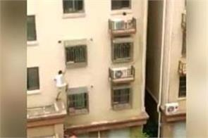 neighbour saves chinese toddler hanging from fourth floor window