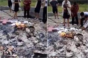 officials destroying crosses burning bibles in china