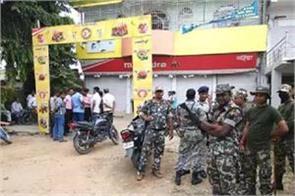 firing at showroom of bjp leader