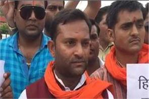 bjp s throat swap by sc st act party worker protested