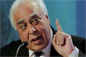 sibal said a fair target of modi if residing in another country resigns
