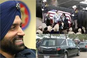 thousands remember slain sikh deputy at funeral service