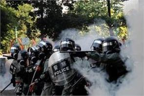 hong kong protester shot with live round during china