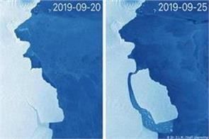 large iceberg breaks apart from antarctica