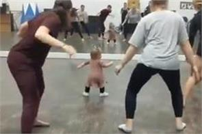 toddler  gym instructor  leads ladies and makes them work out
