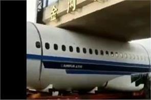 china truck driver gets plane stuck under foot bridge video viral