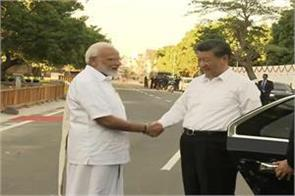pm modi seen in traditional south india dress welcomed jinping