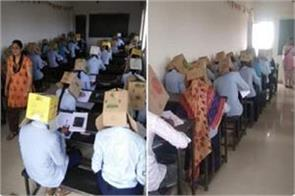 karnataka forcible students wear cardboard boxes to stop copying