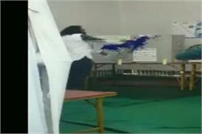bsp leader throws ink on voting machine slashes evm  machine murdabad