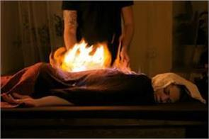 here diseases are treated by setting fire on the patient body