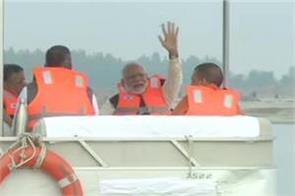 namami gange prime minister narendra modi sat on a boat