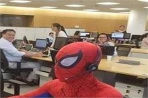 bank employee turns up at work dressed as spiderman on his last day