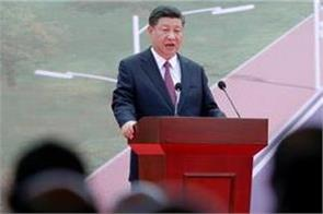 xi jinping says taiwan  must and will be  reunited with china