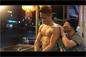 shirtless chicken seller boy became internet sensation  photos goes viral