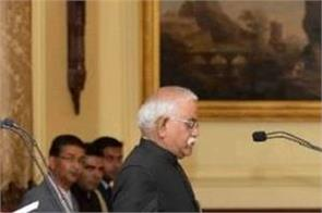 kovind administers the oath to bhargava as chief information commissioner