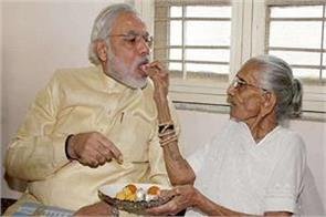 visit of gujarat pm modi visits village and meets mother