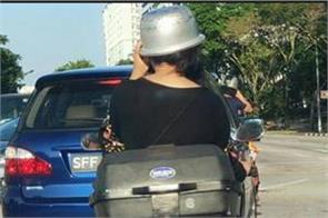woman gets creative  uses rice cooker pot as helmet