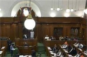 bjp mlas marshalled out of delhi assembly
