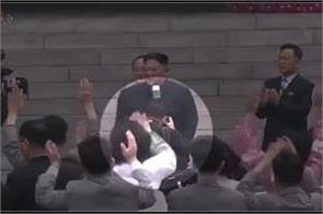 kim fires photographer for blocking crowd s view of him