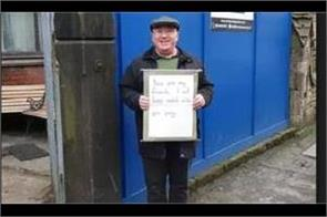 uk man guards mosque with  you are my friends  placard