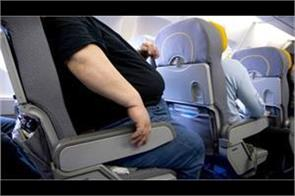 a man charged an obese passenger sitting next to him on a plane