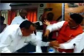 mp sharad tripathi shoots mla rakesh singh with shoes