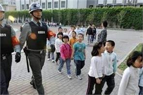 chinese teacher detained for allegedly poisoning 23 children