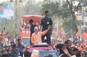 pm modi scolds in road show after road show in varanasi