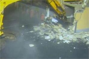 thieves used stolen crane to rip atm from shop wall in ireland
