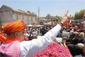 amit shah carried roadshow in sanand in gujarat