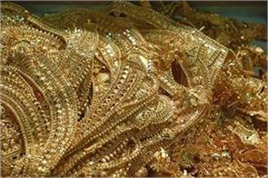 gold futures down by 50 paise against dollar