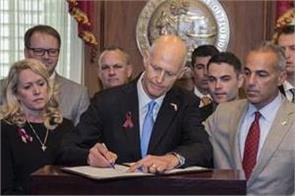 florida governor signs bill to arm more teachers