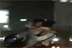couple kiss hug on running bike in delhi road