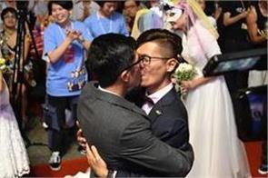 taiwan celebrates asia s first same sex weddings video viral